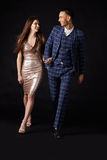 Fashionable young couple walking together arm in arm Stock Image