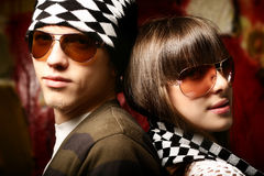 Fashionable young couple wearing sunglasses. Art photo Stock Images