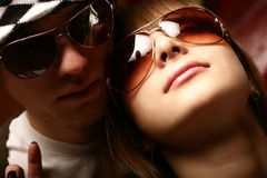 Fashionable young couple wearing sunglasses Stock Photography
