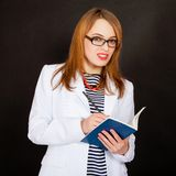 Fashionable young female doctor. Royalty Free Stock Photography