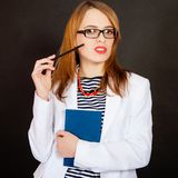 Fashionable young female doctor. Royalty Free Stock Images