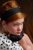 Fashionable young girl. Portrait of fashionable young girl with red hair looking over shoulder Royalty Free Stock Photography