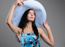 Fashionable young girl in a hat Stock Image