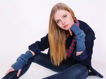 Fashionable young girl in jeans clothes Stock Photos