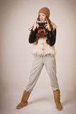 Fashionable young girl with old camera Royalty Free Stock Photography