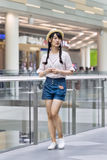 Fashionable young girl in a shopping mall, Beijing, China stock photo