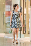 Fashionable young girl in a shopping mall, Beijing, China royalty free stock photography