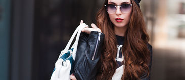 The fashionable young girl in sunglasses Royalty Free Stock Image