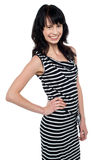 Fashionable young girl in trendy sleeveless attire Royalty Free Stock Images