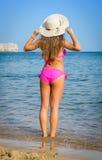 Fashionable young girl on tropical beach Stock Photos