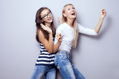 Fashionable young girls posing. Stock Images