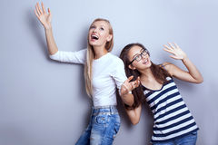Fashionable young girls posing. Royalty Free Stock Images