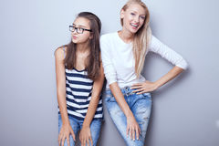 Fashionable young girls posing. Stock Image