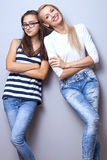 Fashionable young girls posing. Royalty Free Stock Photos