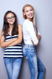 Fashionable young girls posing. Royalty Free Stock Image