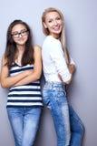Fashionable young girls posing. Royalty Free Stock Image