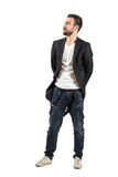 Fashionable young guy with hands on his back looking away Stock Images