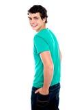Fashionable young guy turning back Stock Photo
