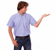 Fashionable young male in jeans with palm out.. Stock Image