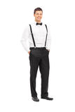Fashionable young man with bow-tie posing Royalty Free Stock Images