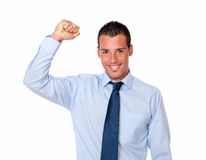 Fashionable young man celebrating his victory Royalty Free Stock Images