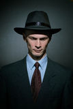 Fashionable young man detective in a stylish hat Royalty Free Stock Images
