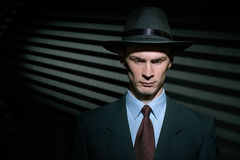 Fashionable young man detective in suit and trilby hat Royalty Free Stock Photos