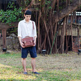 Fashionable young man with leather bag Royalty Free Stock Images
