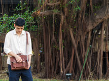 Fashionable young man with leather bag Royalty Free Stock Photos