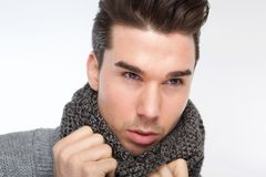 Fashionable young man posing with gray wool scarf Royalty Free Stock Images