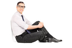 Fashionable young man sitting on the floor Stock Photography