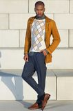 Fashionable young man standing outdoors Royalty Free Stock Photos
