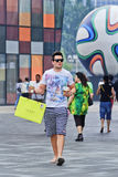 Fashionable young man with Starbucks drink, Beijing, China royalty free stock photos