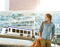Fashionable young man traveling with bag Royalty Free Stock Photography