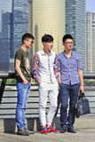Fashionable young men on Bund boulevard with Pudong on background, Shanghai, China royalty free stock photography