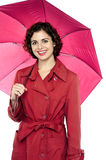 Fashionable young model posing with an umbrella Royalty Free Stock Image
