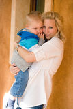 Fashionable young mother with her son. Royalty Free Stock Photo