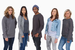 Fashionable young people in a line Stock Images
