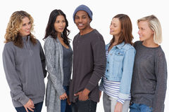 Fashionable young people in a row all looking at man Royalty Free Stock Photography