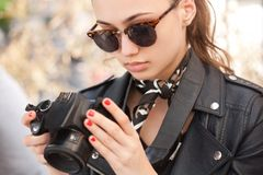 Fashionable young photographer. Stock Photos