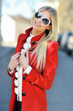 Fashionable young sensual model girl wearing sunglasses Stock Image