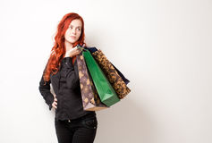Fashionable young shopper. Stock Photos