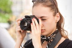 Fashionable young photographer. Royalty Free Stock Images