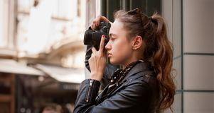 Fashionable young photographer. Royalty Free Stock Photography