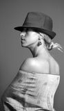 Fashionable young woman. Side view of fashionable young blond woman in studio, black and white photograph Royalty Free Stock Photography