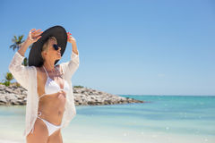 Fashionable young woman on the beach Stock Images