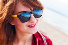 Fashionable young woman on the beach Stock Photography