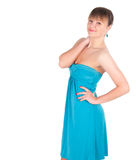 Fashionable young woman in beautiful blue dress posing at studio Stock Images