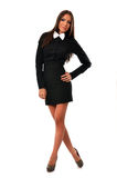 Fashionable young woman in black mini dress with white bowtie Stock Photo