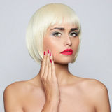 Fashionable young woman. Fashionable young blond woman with beautiful makeup Royalty Free Stock Images